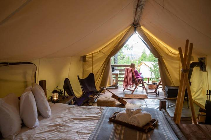 If you're OK with a tent so long as it's well outfitted, you could consider renting a glamp ...