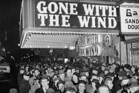 In this Dec. 19, 1939, file photo, a crowd gathers outside the Astor Theater on Broadway during ...