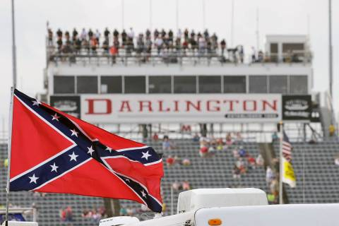 FILE - In this Sept. 5, 2015, file photo, a Confederate flag flies in the infield before a NASC ...