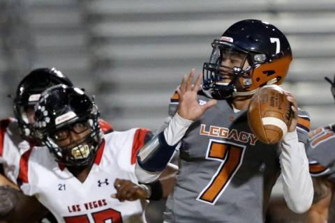 Legacy's quarterback Evan Olaes (7) looks to throw the ball as Las Vegas' Markell Jackson (57) ...