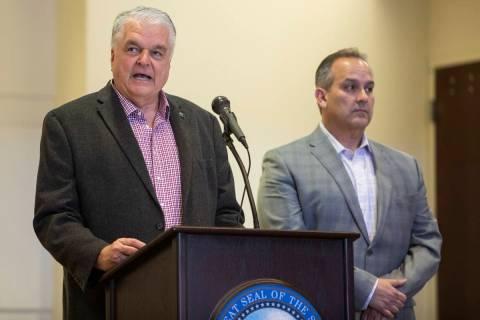 Gov. Steve Sisolak, left, and Clark County School District Superintendent Jesus Jara announce t ...