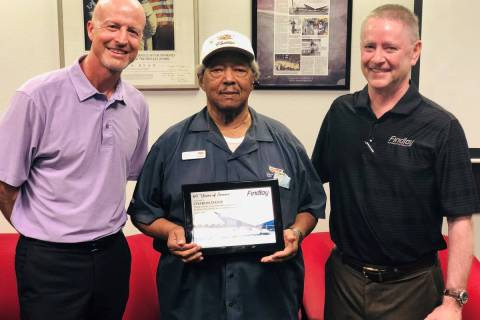 Longtime Findlay Automotive Group employee Charles Davis, center, is flanked by Findlay Automot ...