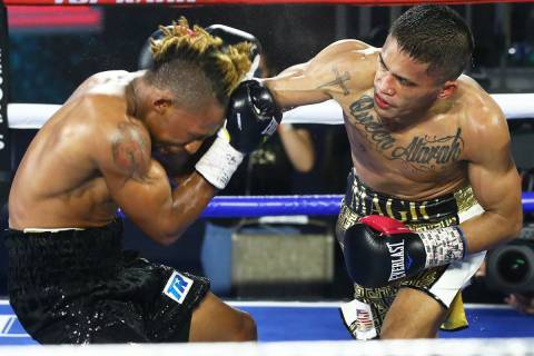 Mike Plania, right, connects against Joshua Greer Jr. during their bantamweight fight inside th ...