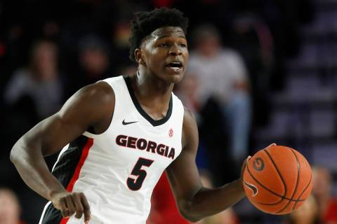 In this Friday, Oct. 18, 2019, file photo, Georgia's Anthony Edwards (5) dribbles the ball up d ...
