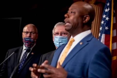 Sen. Tim Scott, R-S.C., right, accompanied by Senate Majority Leader Mitch McConnell of Ky., se ...