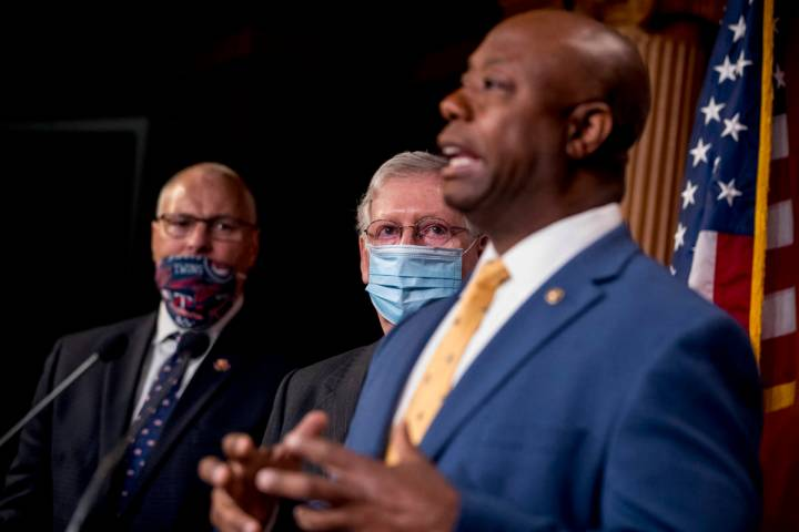 Sen. Tim Scott, R-S.C., right, accompanied by Senate Majority Leader Mitch McConnell of Ky., se ...