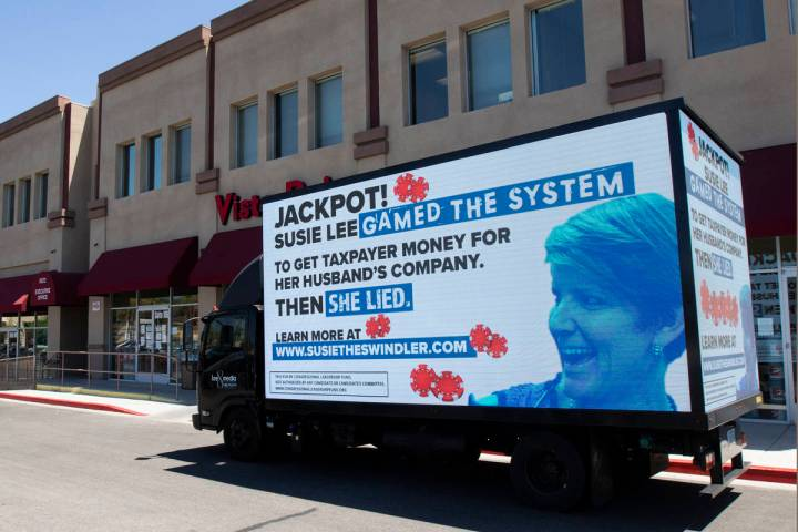 A mobile billboard attacking Rep. Susie Lee drives in front of Lee's office in Las Vegas on Thu ...