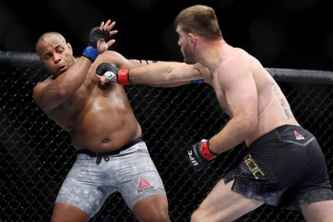 Stipe Miocic, right, battles Daniel Cormier in the heavyweight title bout during UFC 226 at T-M ...