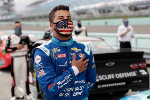 Bubba Wallace stands for the national anthem before a NASCAR Cup Series auto race Sunday, June ...