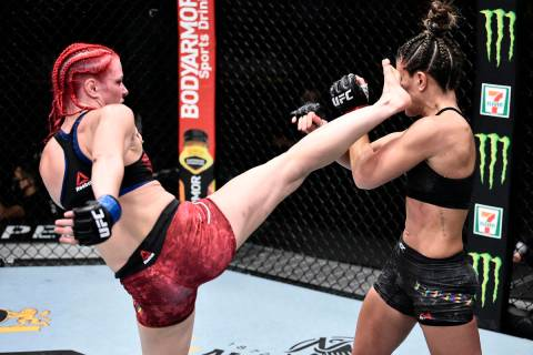 Gillian Robertson of Canada kicks Cortney Casey in their flyweight bout during the UFC Fight Ni ...