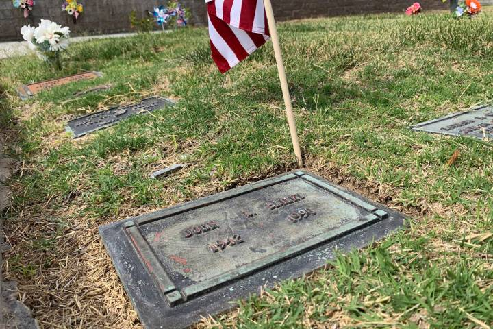 The gravesite of FBI Special Agent John Bailey is seen with an American flag on Thursday, June ...