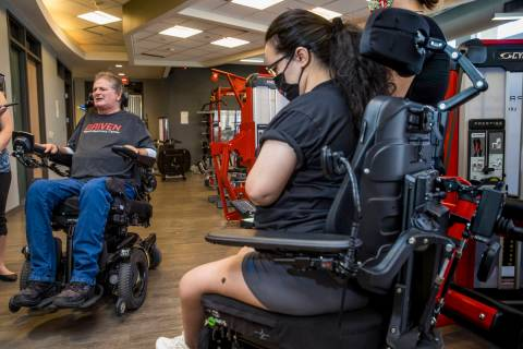 Quadriplegic IndyCar team owner Sam Schmidt, left, talks about the upcoming free virtual workou ...