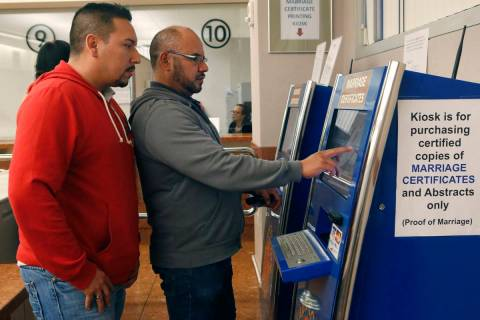 Raul Luna, 37, left, and Luis Zamarripa, 49, right, purchases their marriage certificate at th ...