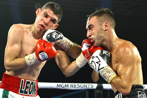 Jason Moloney, right, and Leonardo Baez fight Thursday, June 25, 2020, on a Top Rank boxing car ...