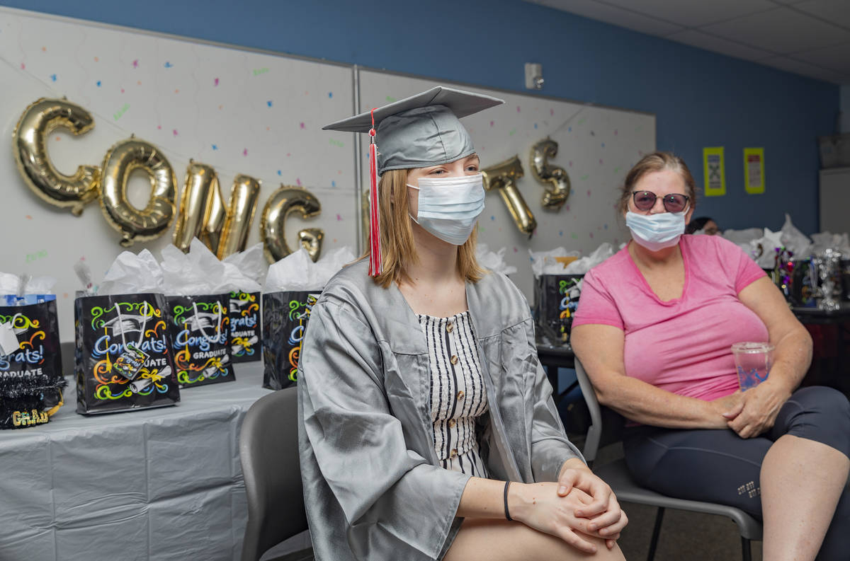 Arbor View High School graduate Joselyn Smith, left, and her foster parent Tami Soudbakhsh chat ...