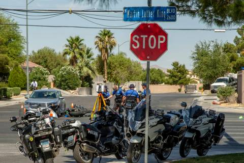 A Major Crash Investigation Unit records the scene of a downed motorcycle and car collision as ...