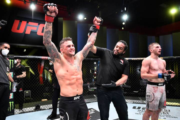 Dustin Poirier celebrates after his victory over Dan Hooker of New Zealand in their lightweight ...