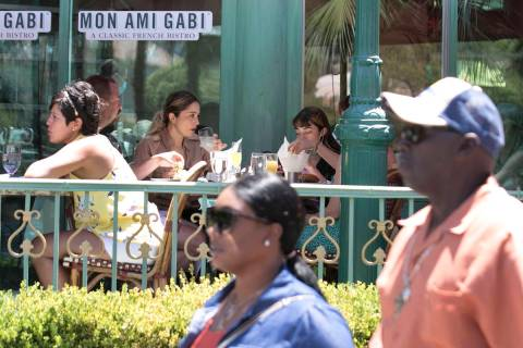 Tourists enjoy their meals in the outdoor dinning area at Mon Ami Gabi restaurant on Sunday, Ju ...