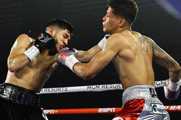Junior welterweight Alex Saucedo makes contact against Sonny Fredrickson on Tuesday night at th ...