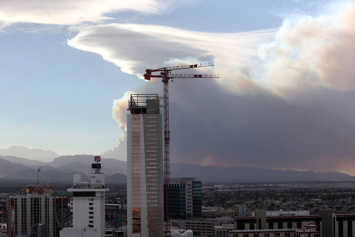 Smoke from a wildfire at Mount Charleston is seen from downtown Las Vegas Sunday, June 28, 2020 ...