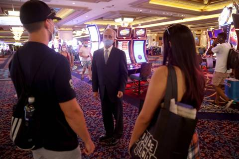 Mandalay Bay President Chuck Bowling talks to newlyweds Jadon and Nicole Brisendine of Sacramen ...