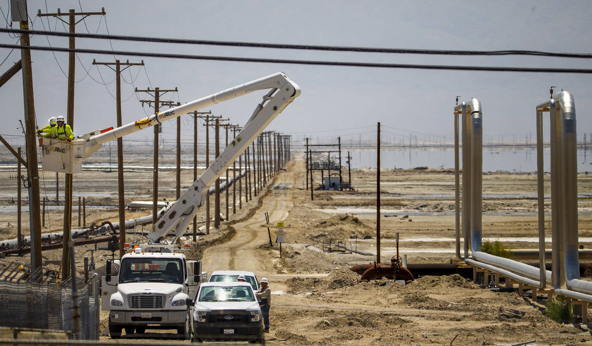 A Southern California Edison crew works to repair the power lines near the Searles Valley Miner ...