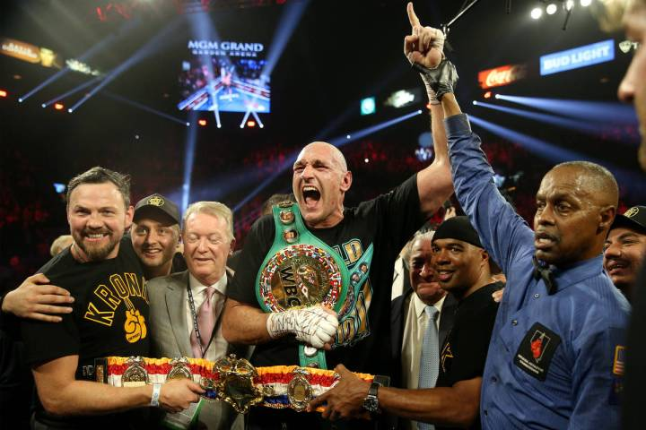 Tyson Fury celebrates technical knockout win against Deontay Wilder in round 7 of the WBC world ...