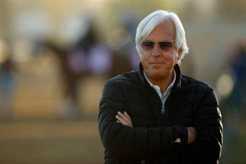 Trainer Bob Baffert watches a morning workout at Churchill Downs Tuesday, May 1, 2018, in Louis ...