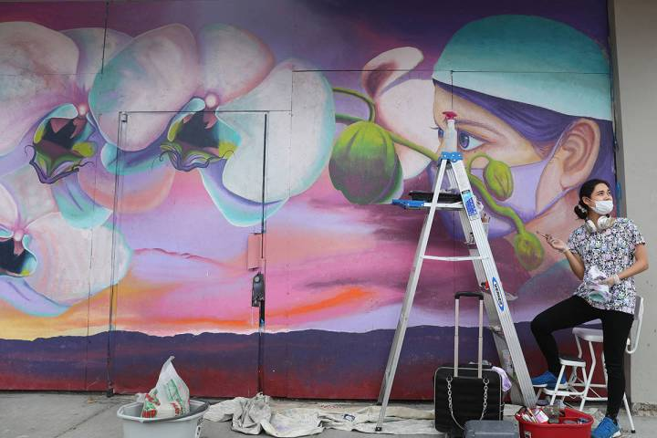 Muralist and staff of Priscilla Fowler Fine Art, Chelsea Rust, paints a mural of a Las Vegas Va ...