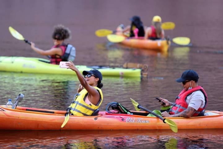 Ashia Paez and Tristan Castillo, both of New York, kayak on the Colorado River in Black Canyon ...