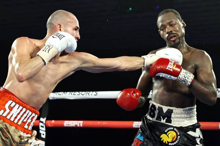 Jose Pedraza punches Mikkel LesPierre during their junior lightweight fight Thursday night at t ...