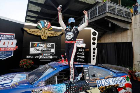 Race driver Kevin Harvick celebrates after winning the NASCAR Cup Series auto race at Indianapo ...