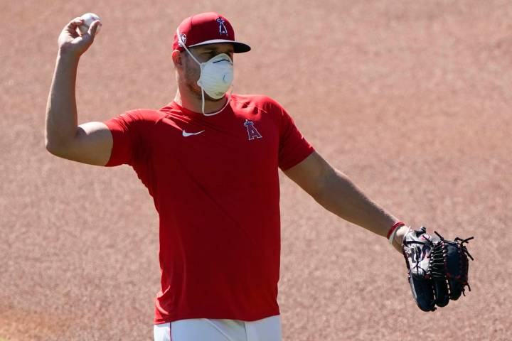 Los Angeles Angels center fielder Mike Trout throws during baseball practice at Angels Stadium ...