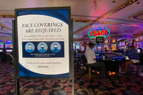 A sign notifying guests of face covering requirement at Four Queens in downtown Las Vegas on Fr ...