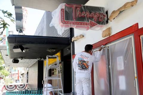 Ismael, left, and Nelson, of CertaPro Painters, who declined to give their last names, paint T ...