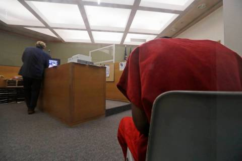 Attorney John Henry Browne, left, stands in view of a video feed as his client Dawit Kelete sit ...