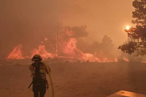 Ad of 9:30 p.m., Monday, July 6, fire was burning on both sides of U.S. Highway 395, south of G ...
