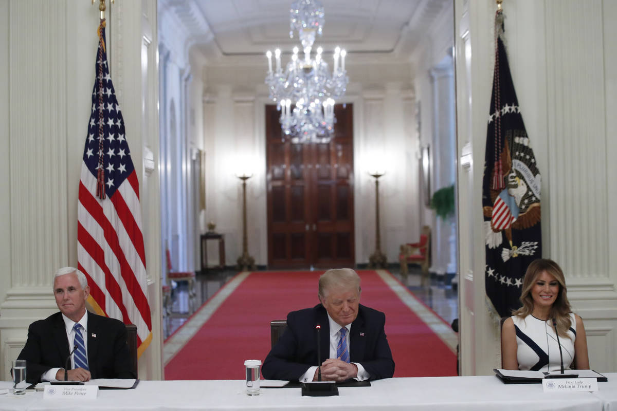 President Donald Trump, Vice President Mike Pence, left, and first lady Melania Trump, attend a ...