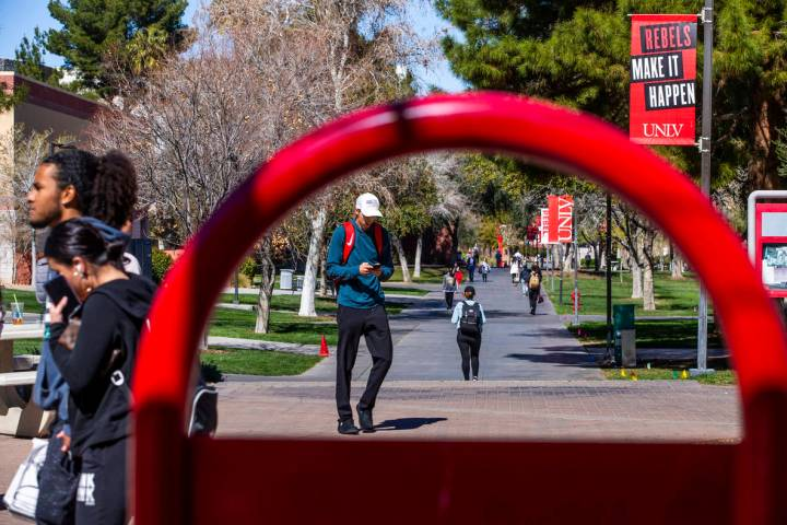 Students walk about the UNLV campus on Tuesday, March 3, 2020 in Las Vegas. (L.E. Baskow/Las V ...