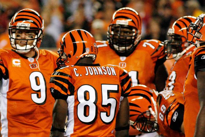 Cincinnati Bengals quarterback Carson Palmer, gesters as receiver Chad Johnson (81) looks on du ...