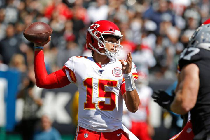 Kansas City Chiefs quarterback Patrick Mahomes looks to throw the ball during the first half of ...