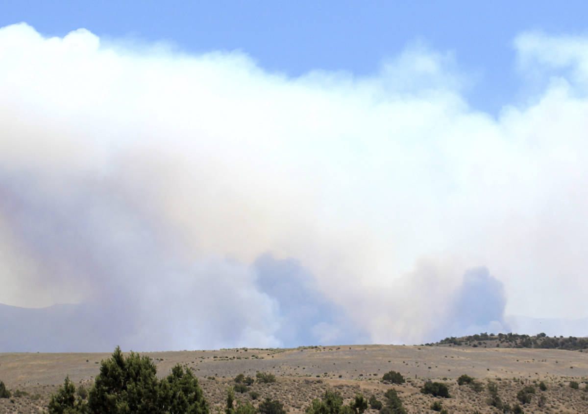 Smoke rises from the Numbers Fire burning east of Gardnerville, Nev., on Tuesday, July 7, 2020. ...