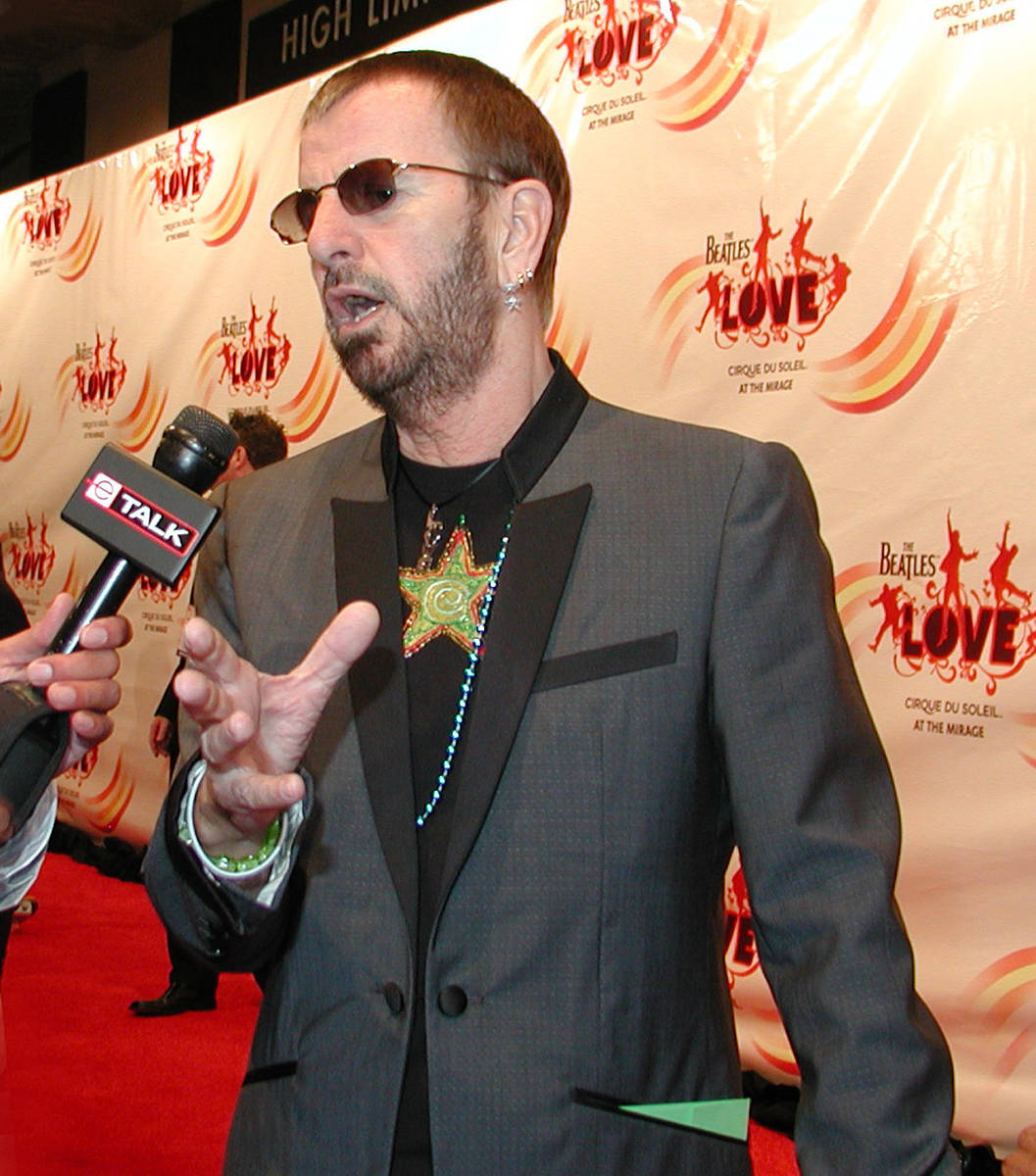 "Ringo Starr is being interviewed arrives at the gala premiere of ""The Beatles LOVE by Cirque du ..."