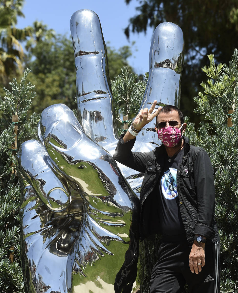 "Musician Ringo Starr poses in front of his ""Peace and Love"" public sculpture on his 8 ..."