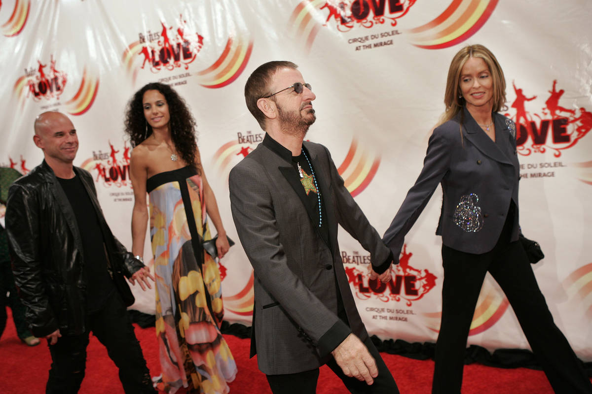 From right Barbara Bach, Ringo Starr, an unidentified woman and Guy Laliberte walk the red carp ...