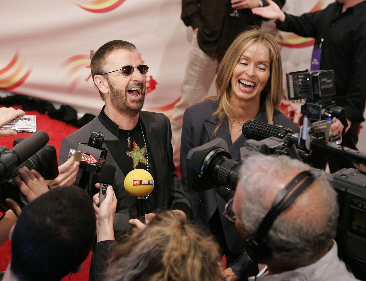 Ringo Starr and his wife Barbara Bach laugh as they talk with he media on the red carpet at the ...