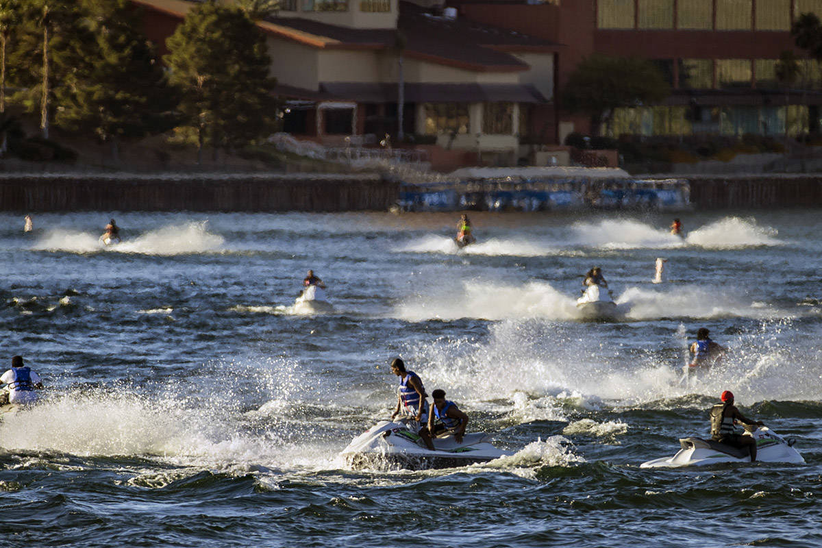 Jetskiers cruise across along the Colorado River about the Bullhead City Community Park during ...