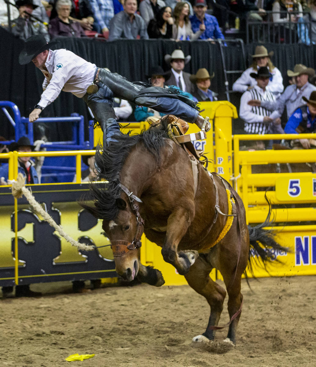 Sterling Crawley of Stephenville, Texas, gets tossed off in Saddle Bronc Riding at the tenth go ...