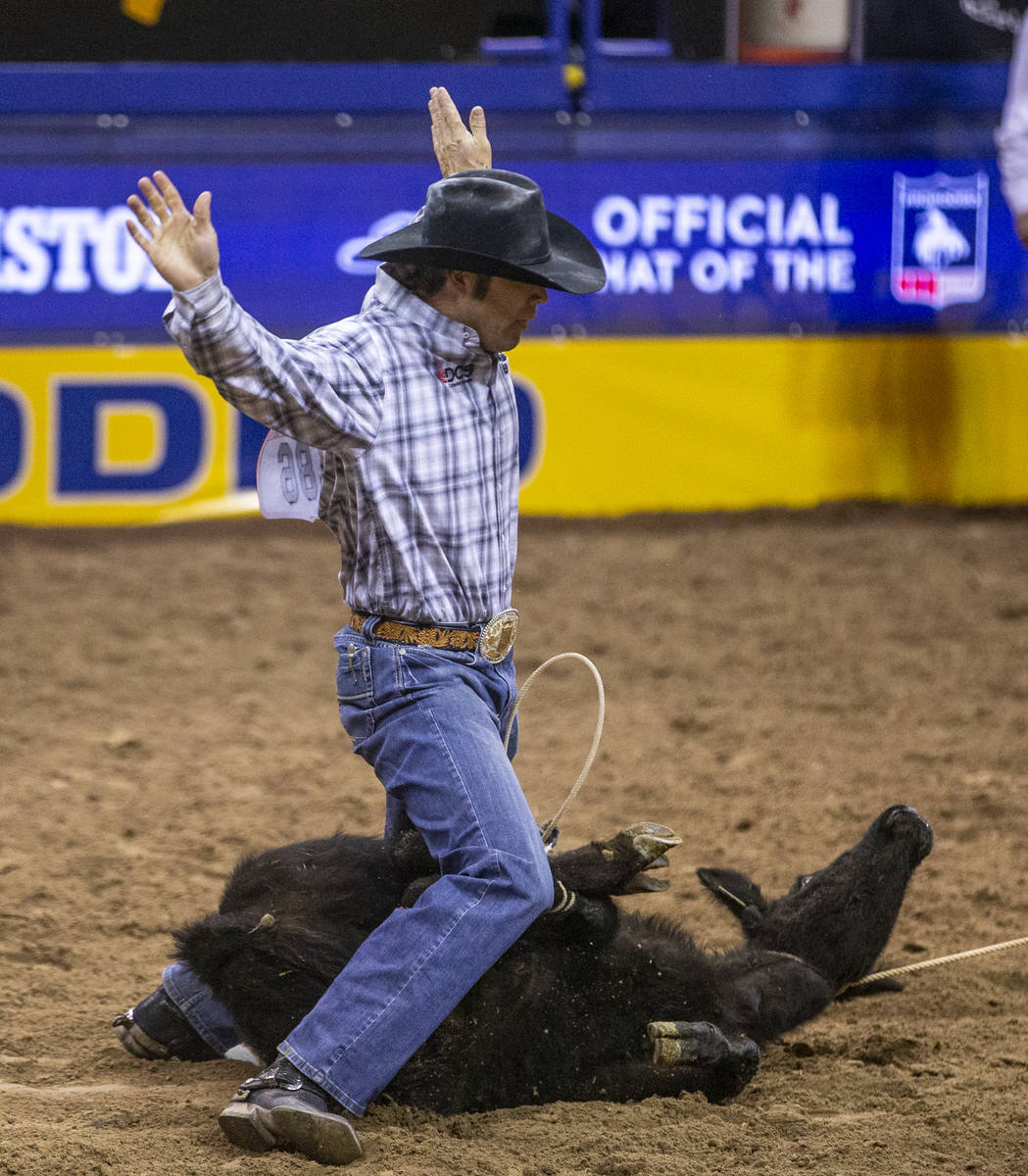 Adam Gray of Seymour, Texas, in Tie-Down Roping at the tenth go round of the Wrangler National ...