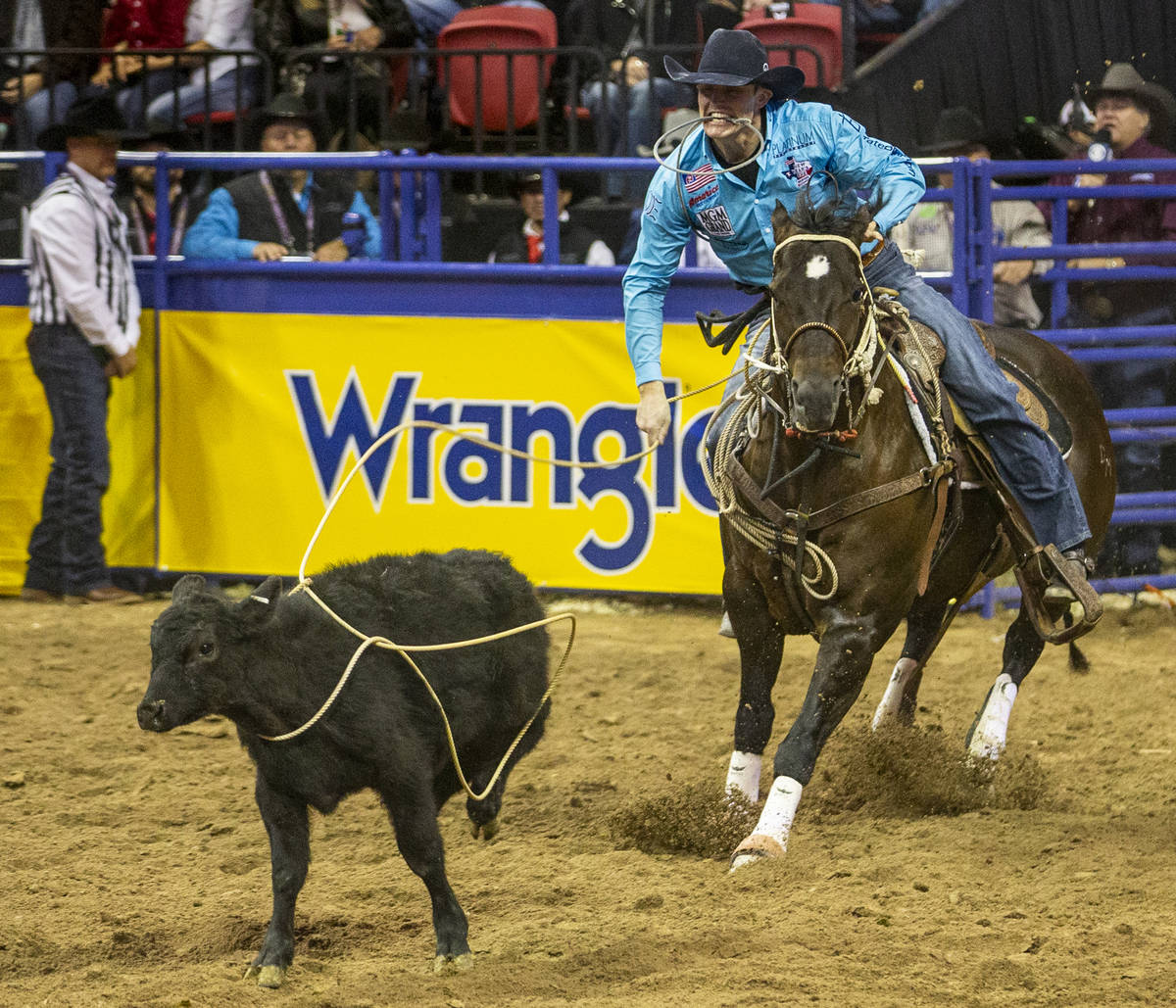 Tuf Cooper of Decatur, Texas, eyes his steer in Tie-Down Roping at the tenth go round of the Wr ...